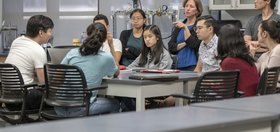 Professor Beth Sattely works with students in the chemistry class.