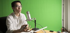 Wes Choy, course producer for online learning, in the studio located in the Packard Building, Room 069, recording a MOOC lecture.